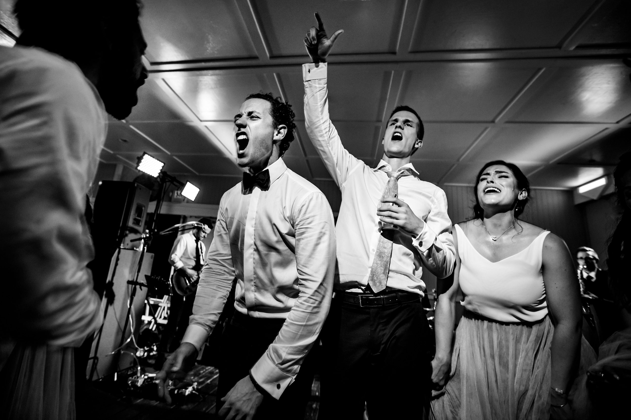 Groom sings with party guests