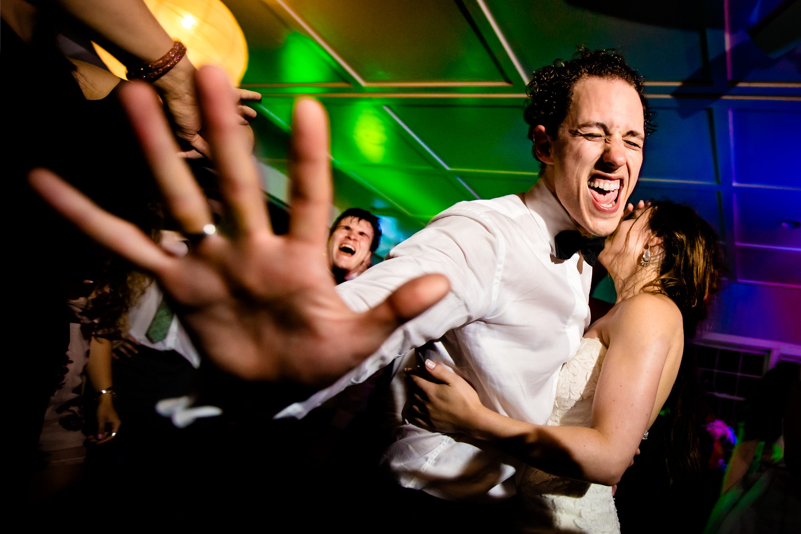 Groom dances passionately with bride at the wedding reception