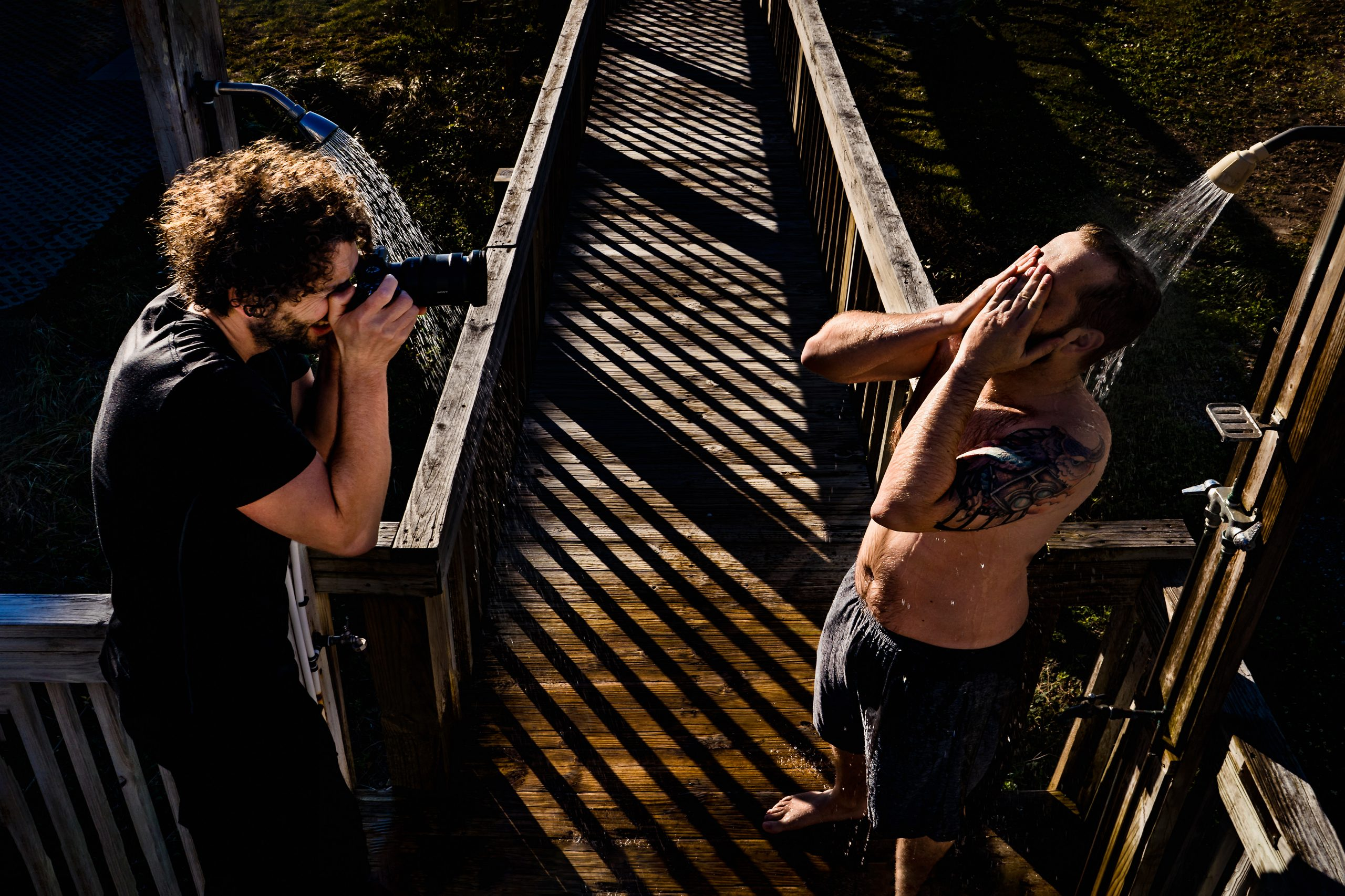 Lanny Mann photographs man showering outdoors.