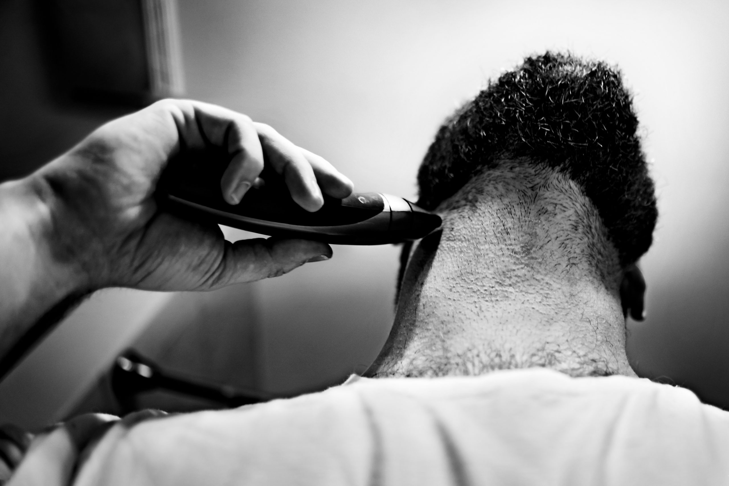 A man trims his beard.