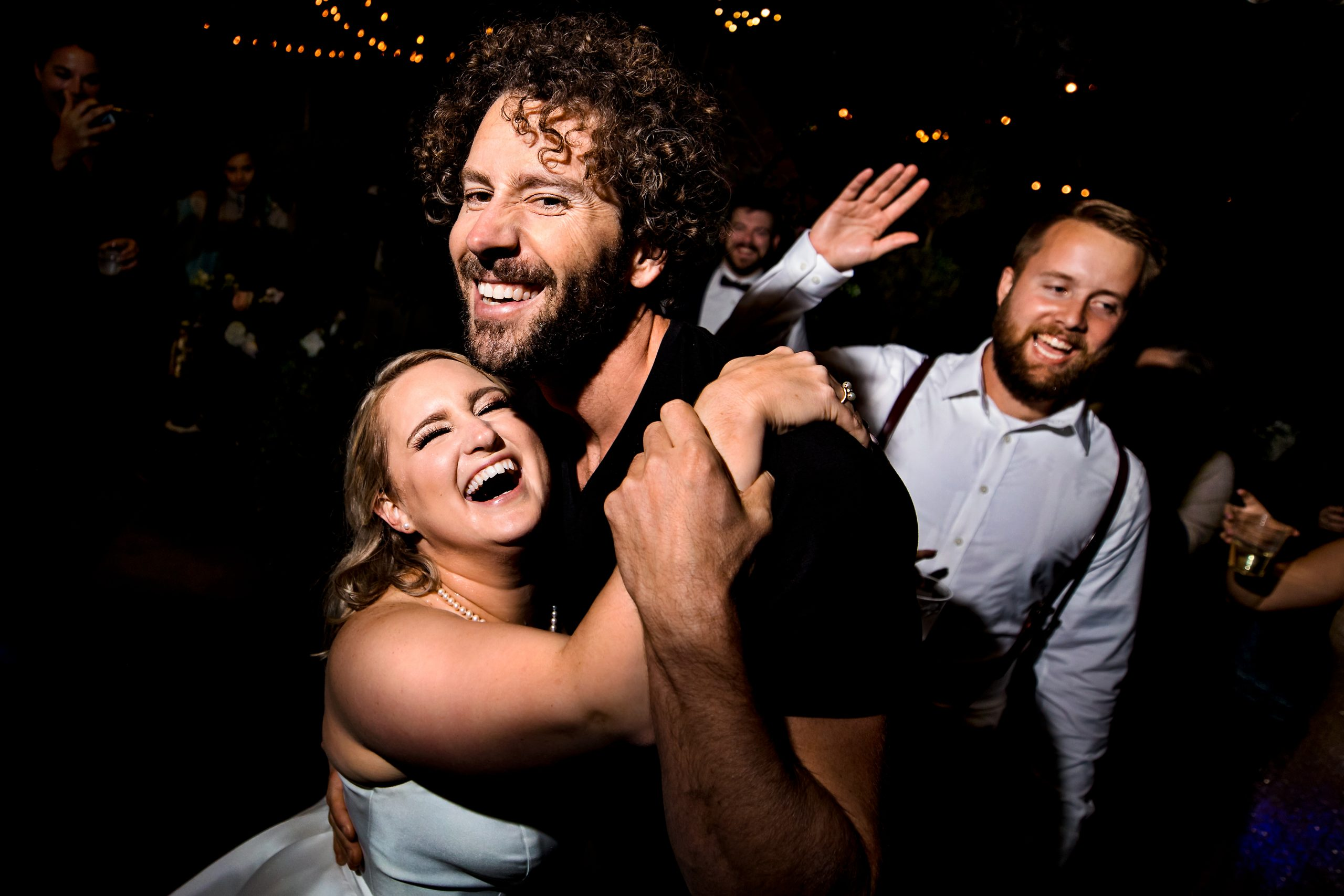 Hugs and smiles for the wedding photographers!