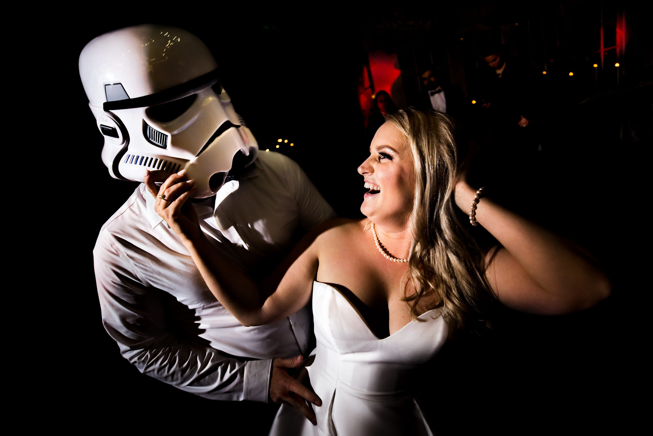 Groom dons a Stormtrooper helmet during the first dance with the bride.