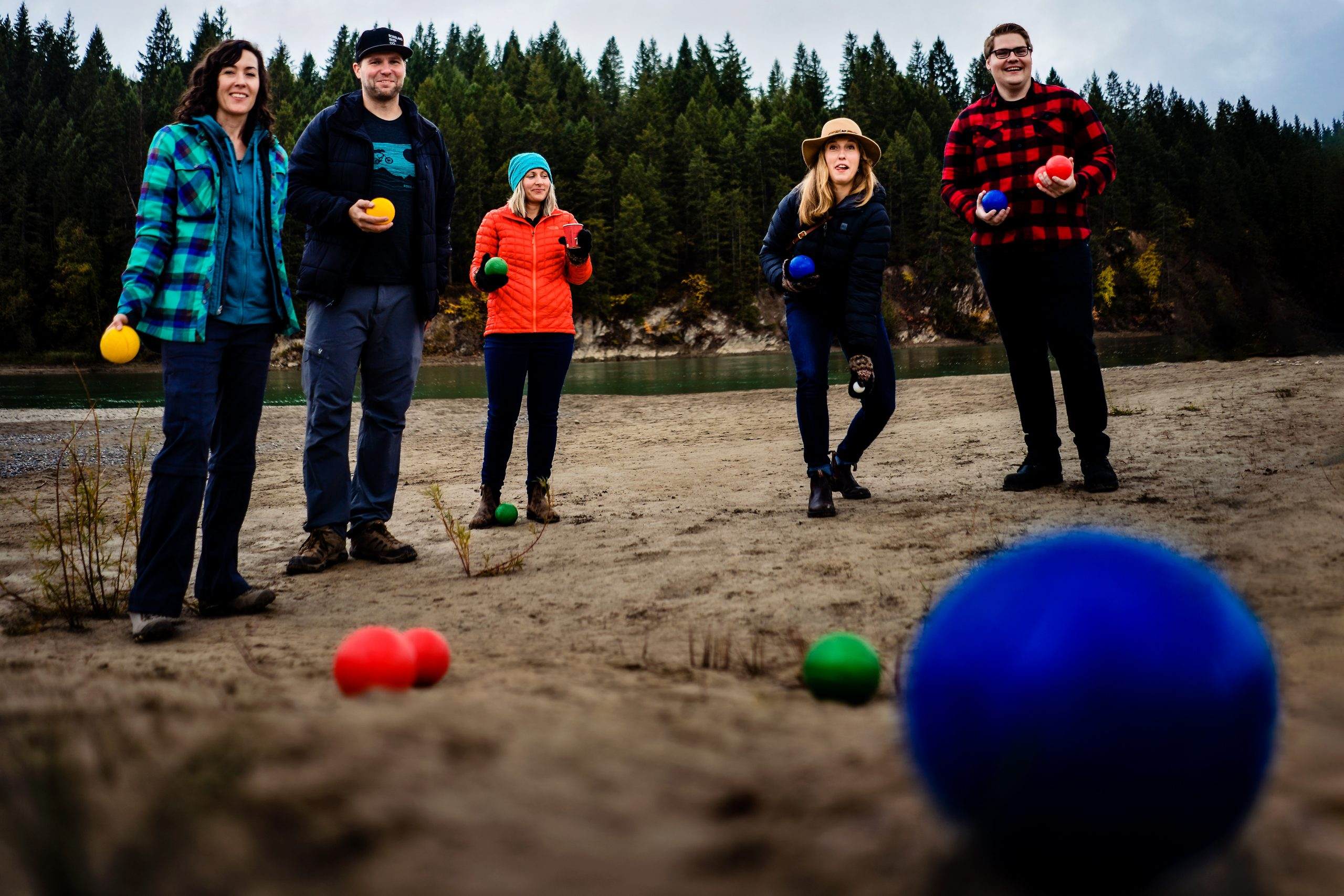 Family members play a game with colorful balls