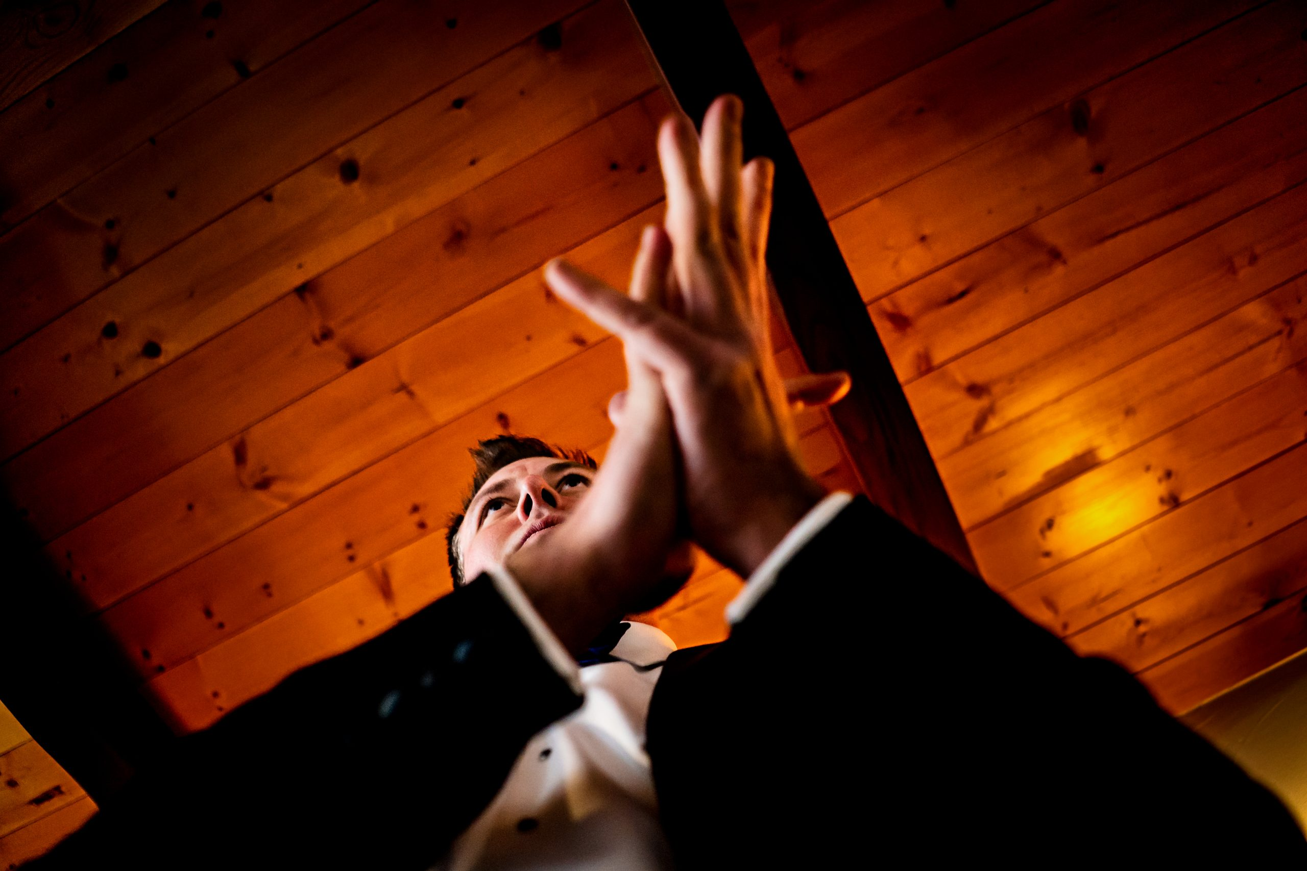 Groom is seen from below anticipating the wedding ceremony.