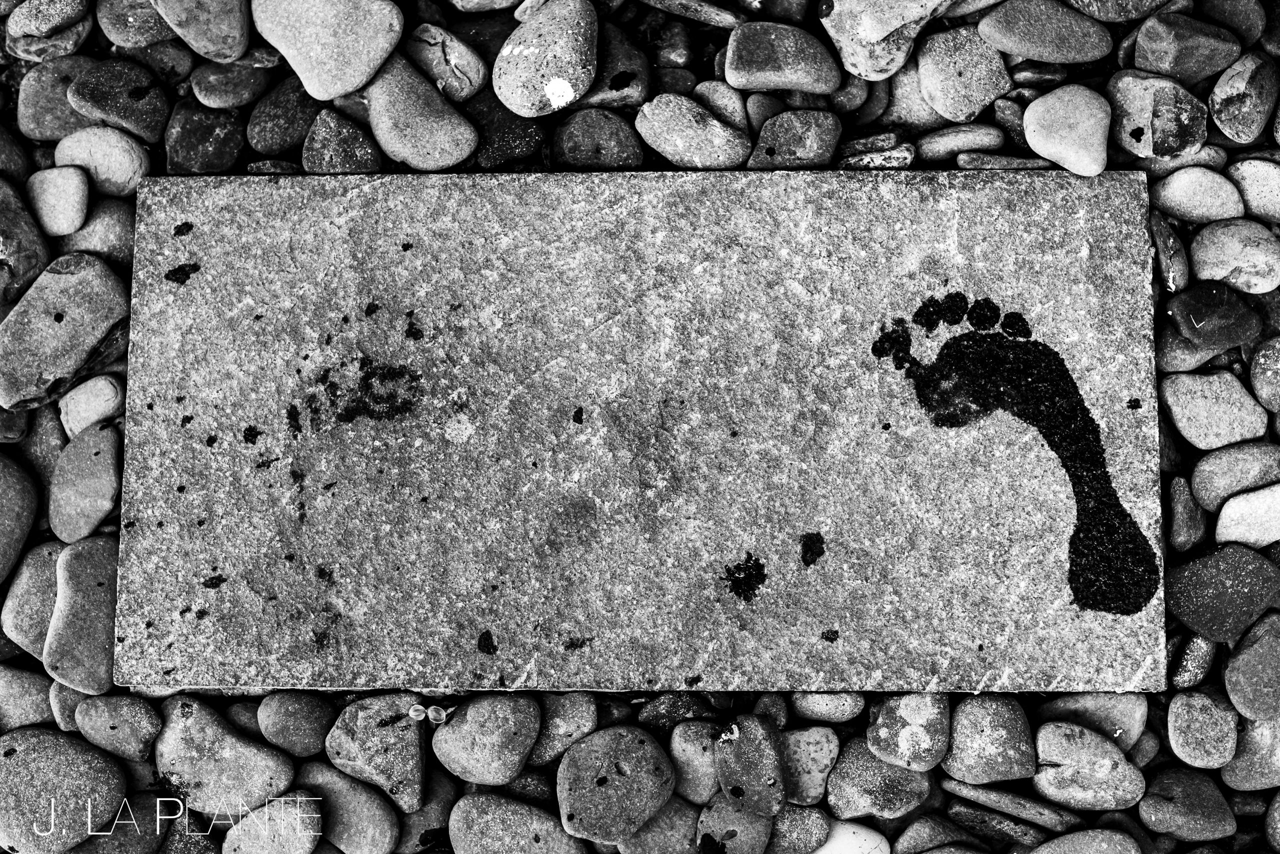 Wet footprint left on a stone slab