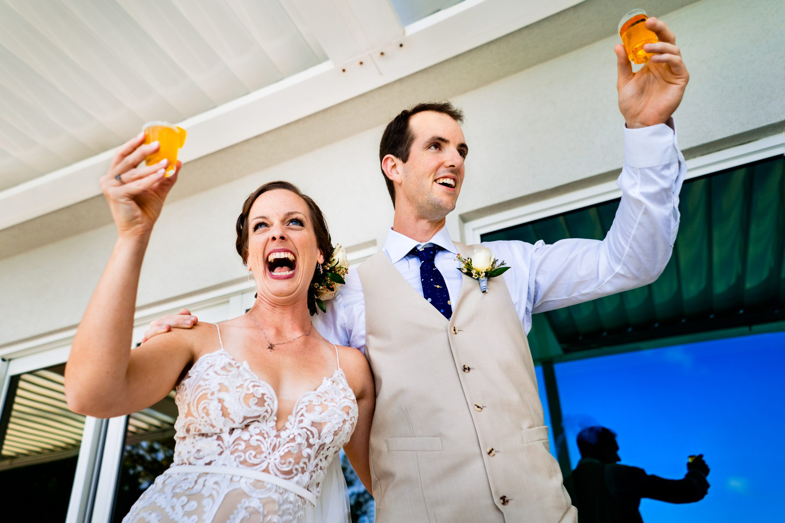 Newlyweds share a toast with their guests