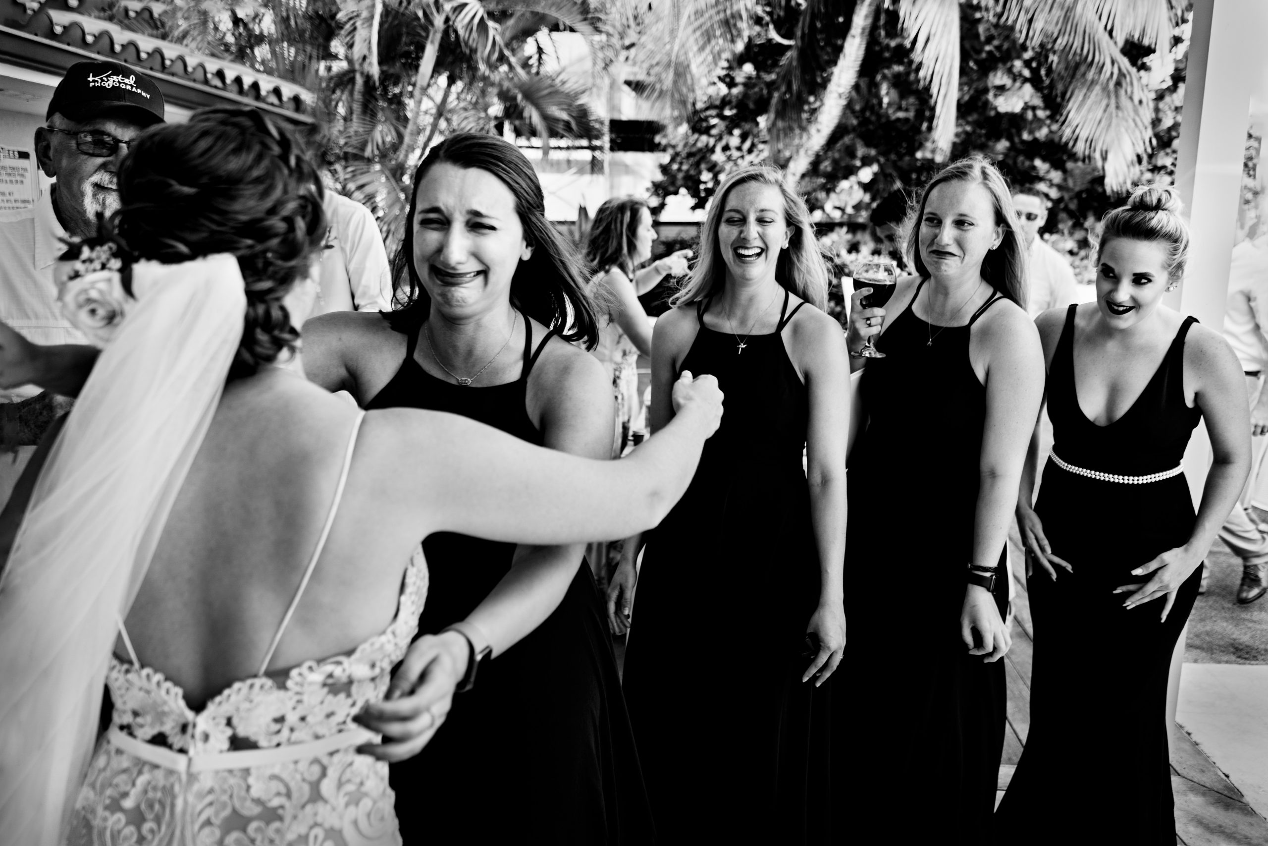 Emotional bridesmaids meet with the bride