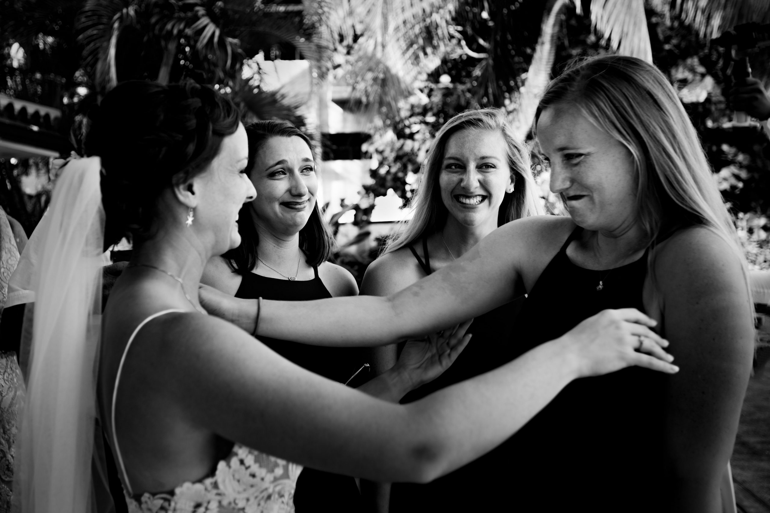 A bride chats with her emotional friends