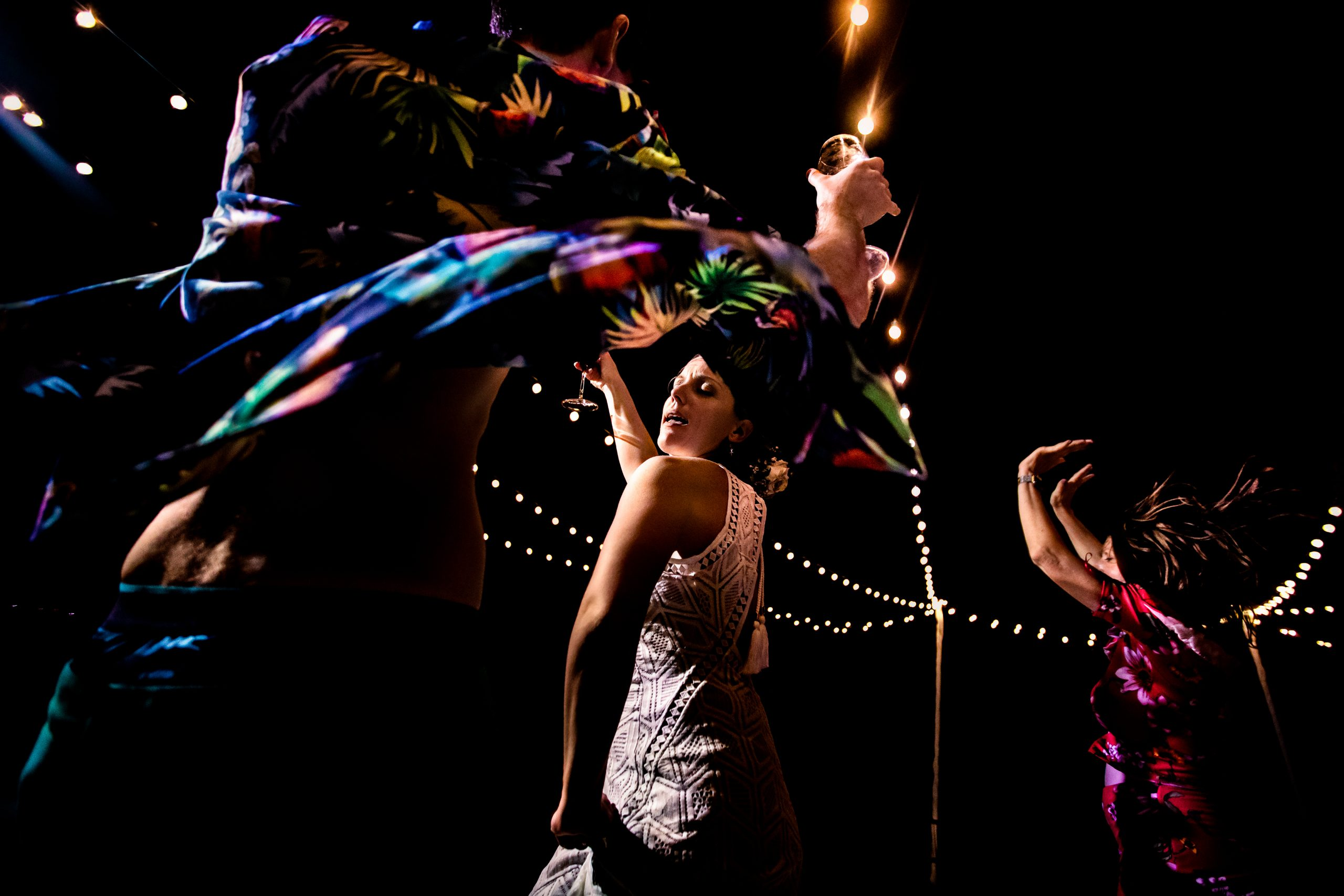 A bride and friends dancing at reception party