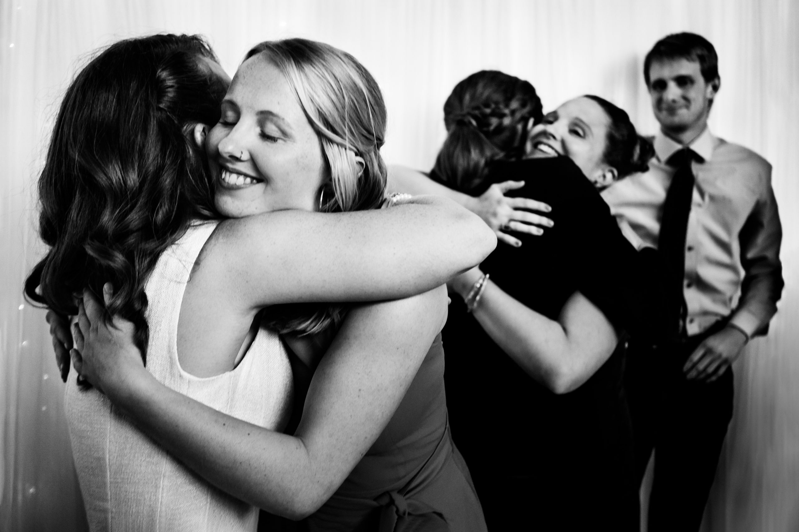 Wedding couple hug their friends