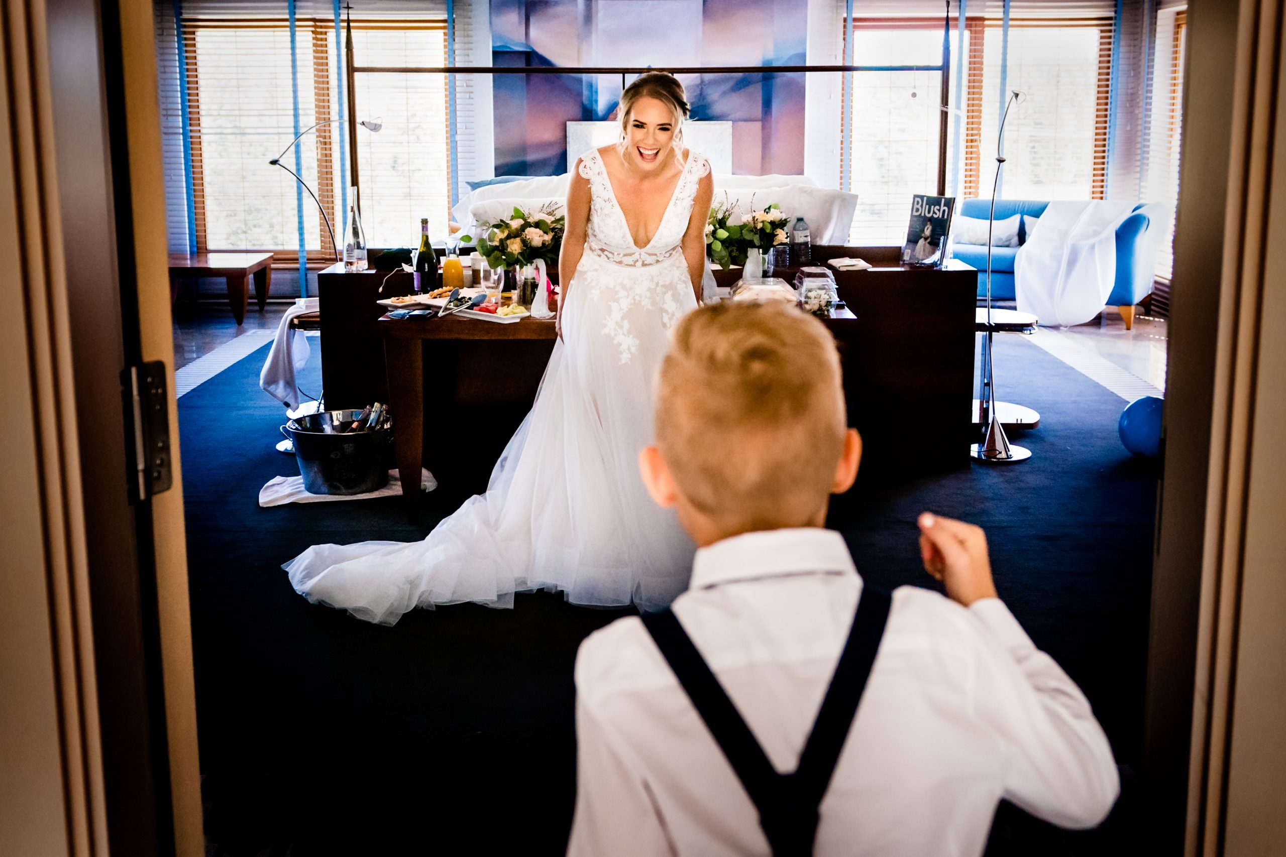 Boy sees his mother in her wedding dress for the first time.