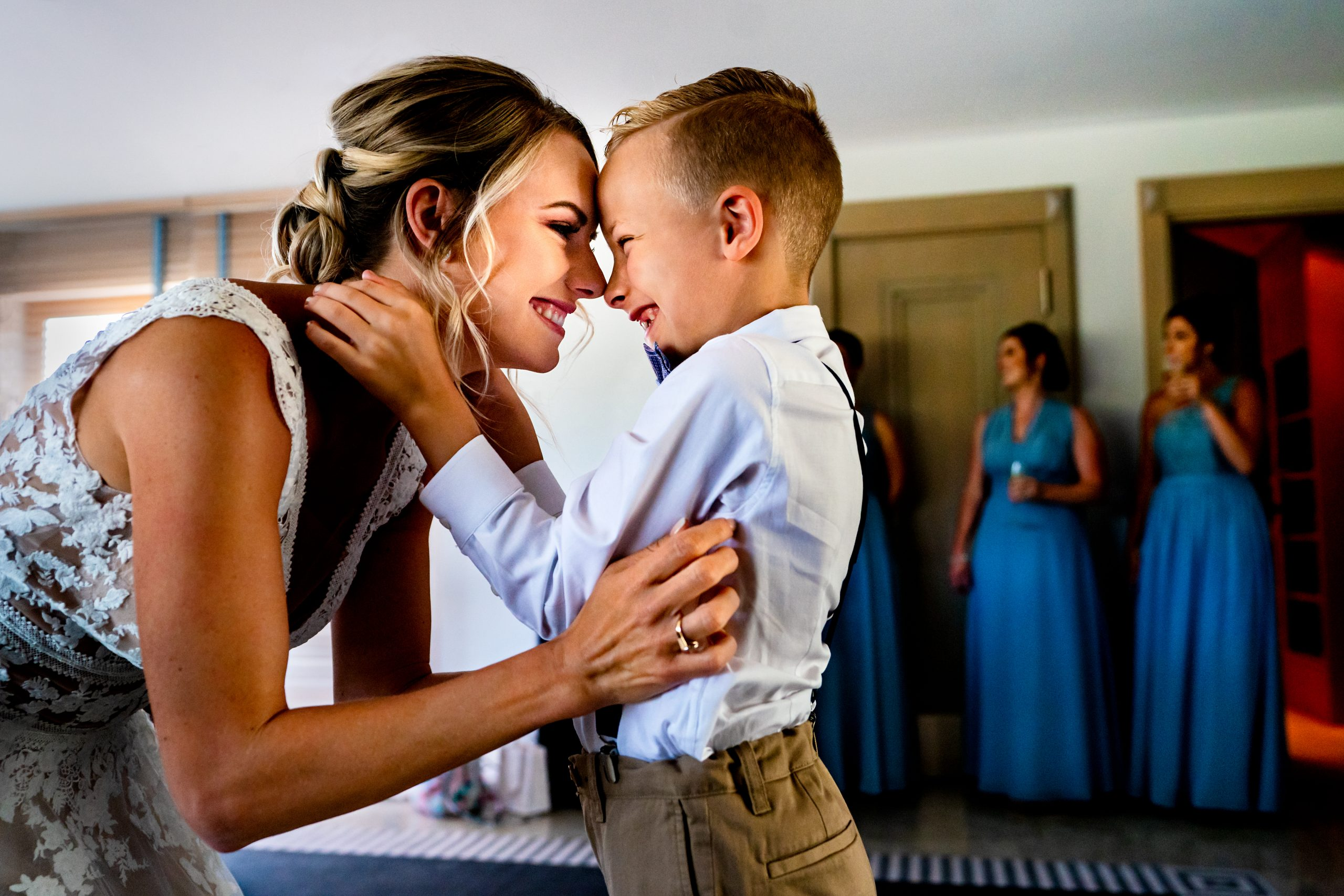 Boy and mother rub noses before the mother's wedding.