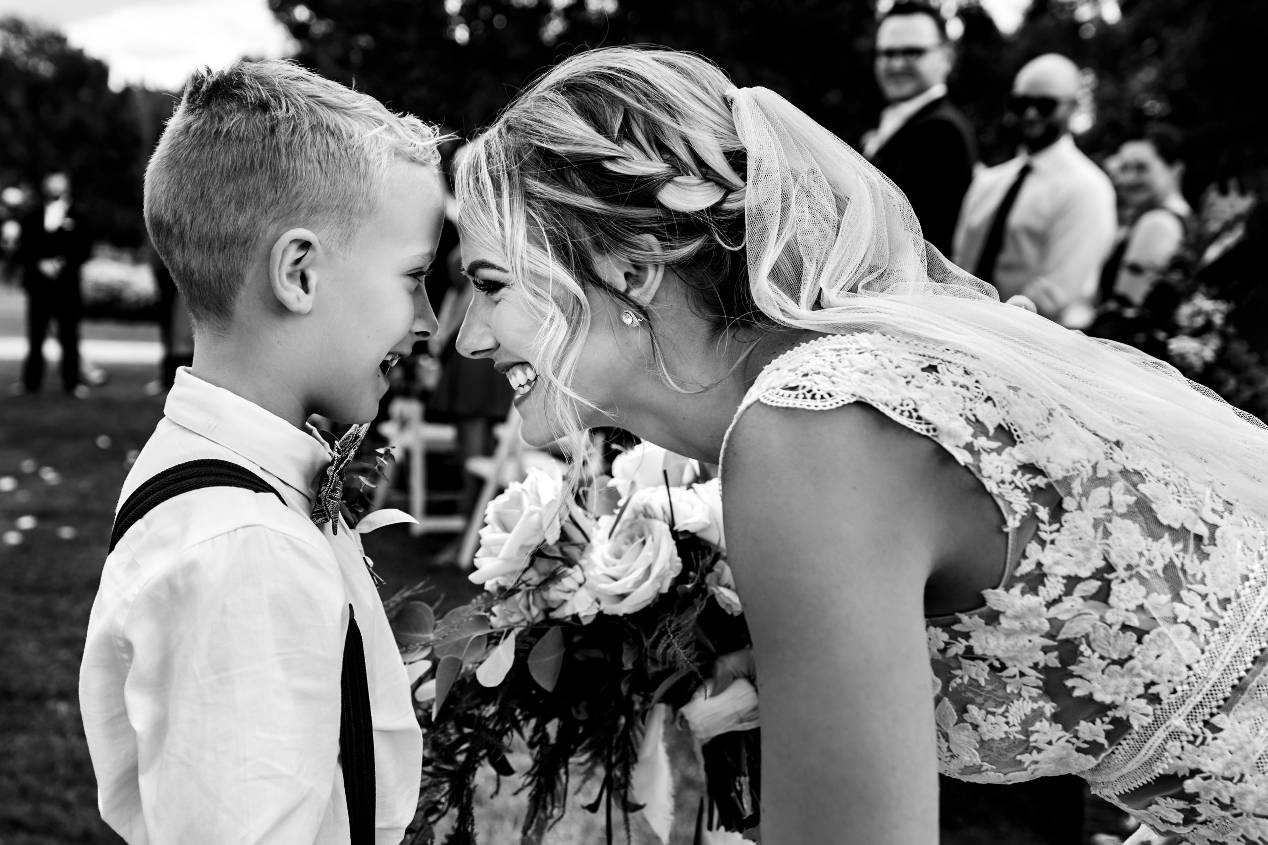 Bride and her son laugh together.