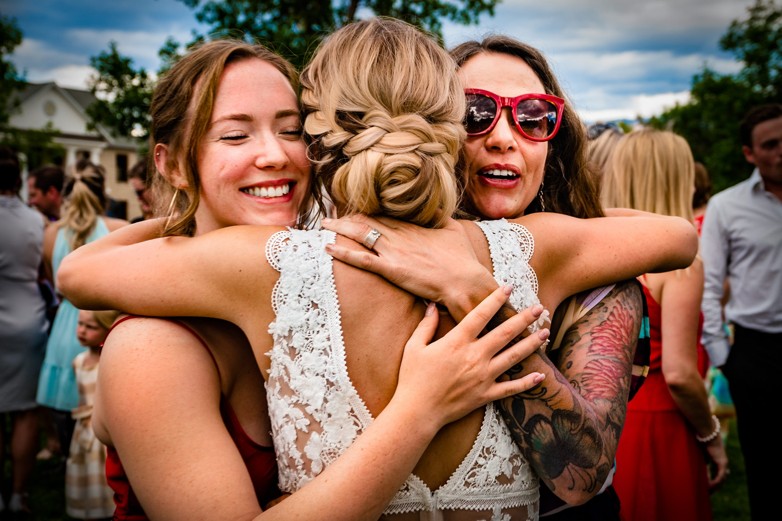 Friends embrace the bride.