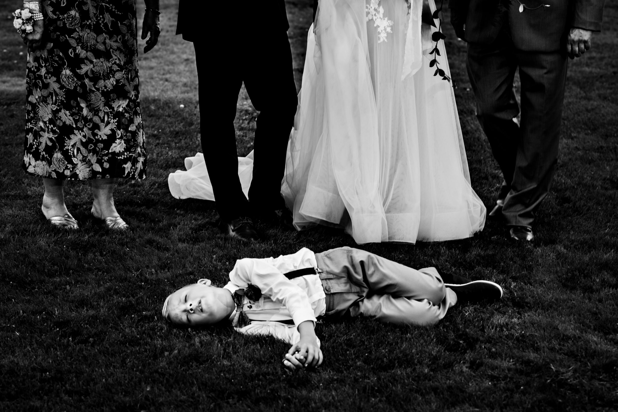 Boy is tired and bored at the wedding ceremony.