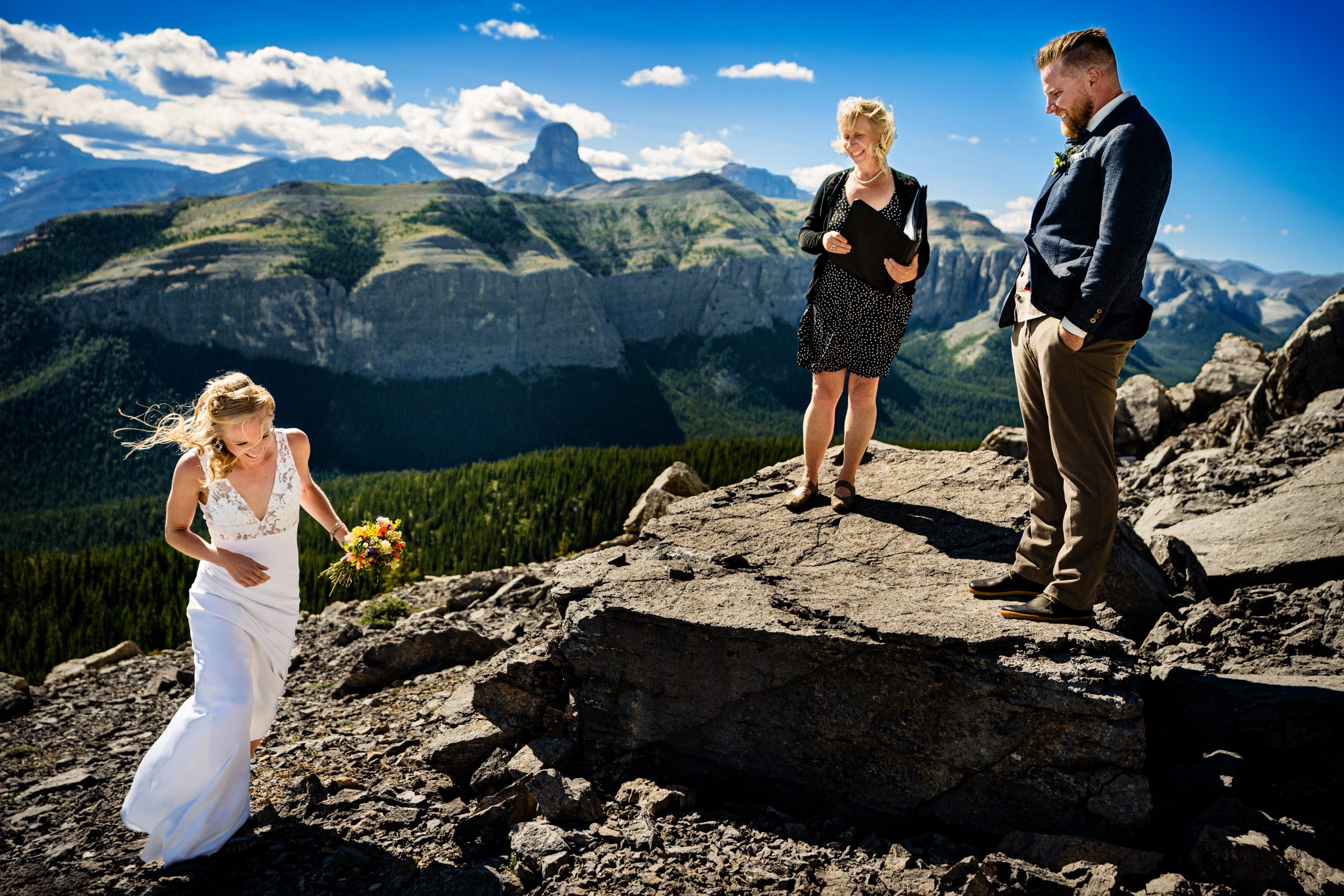 photo of a couple getting married at the top of a moutain