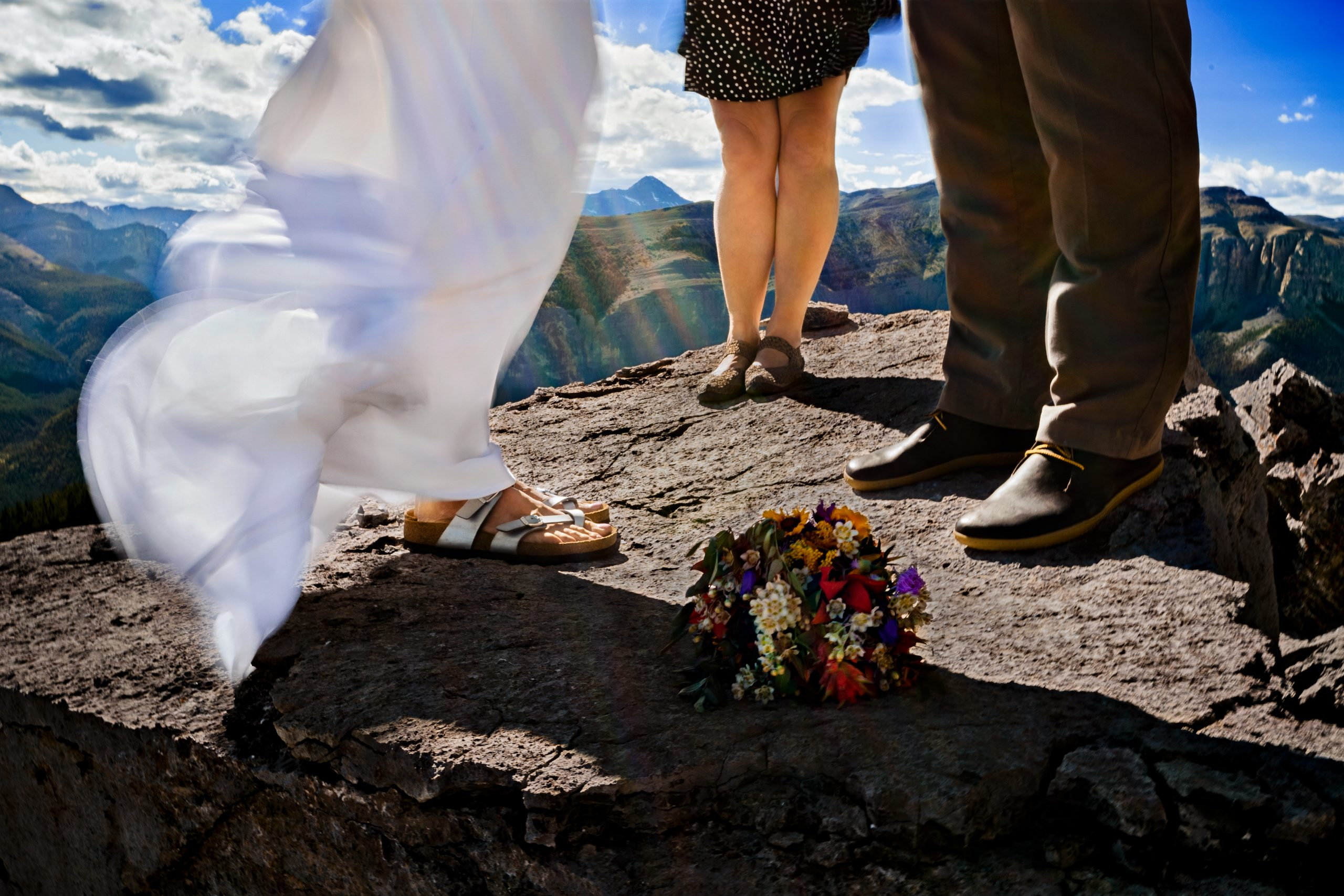 photo of a couple getting married at the top of a mountain