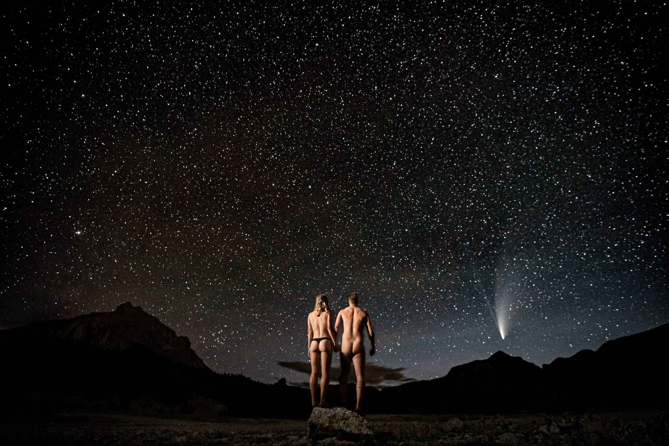 photo of a man and woman outside during a starry night